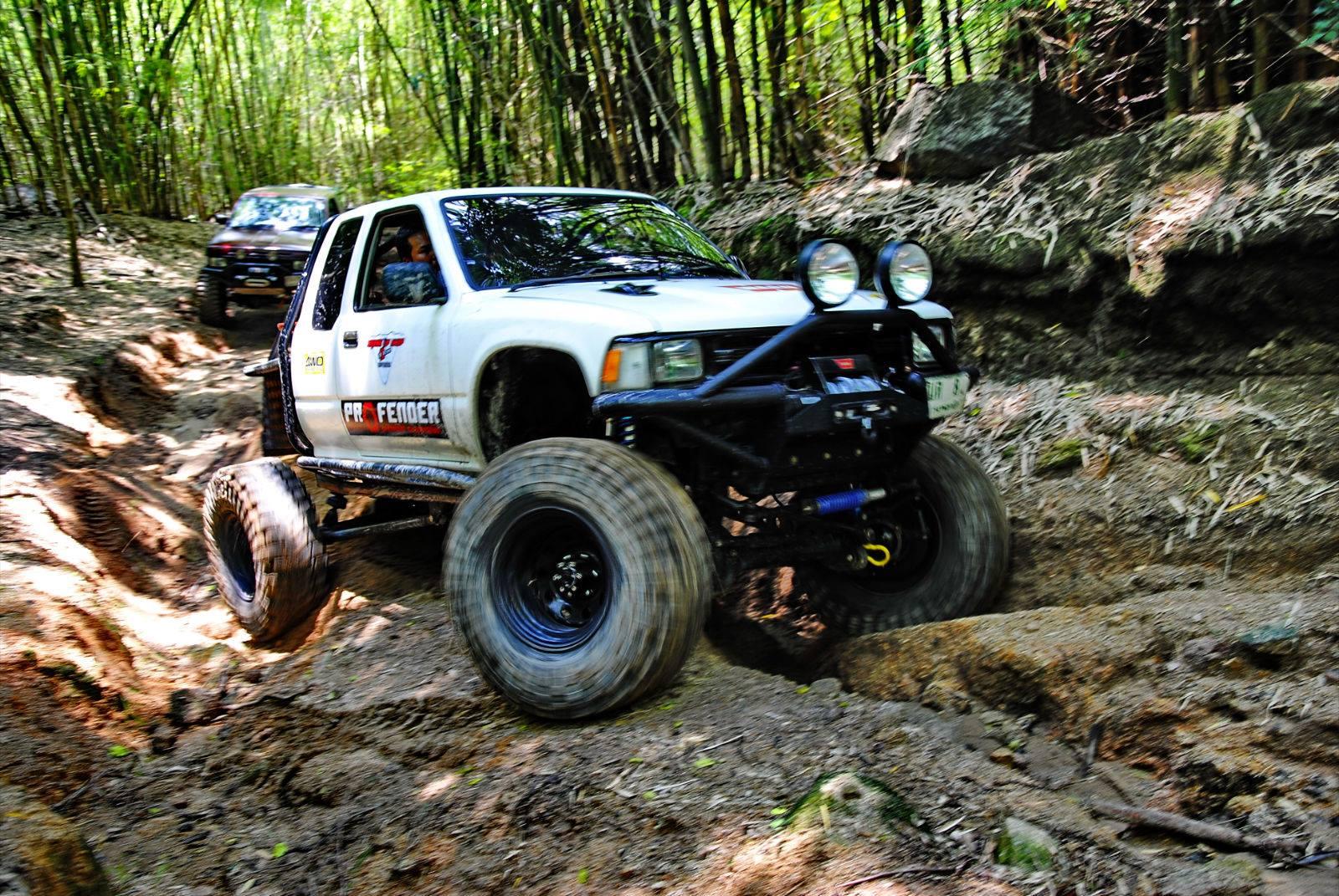 Profender Toyota Vigo driving along a track